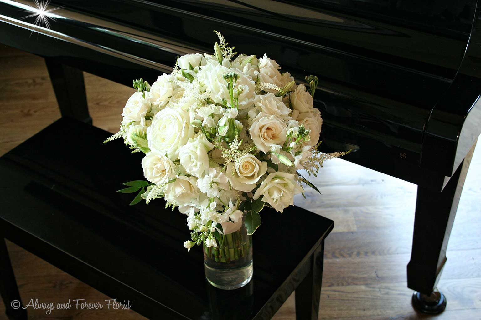 White Bridal Bouquet On Piano Bench